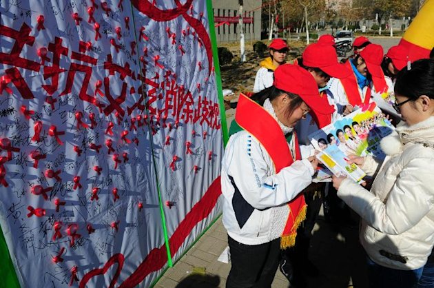 In this file photo, a group of Chinese college students are seen promoting AIDS awareness, during a World AIDS Day campaign in Liaocheng, Shandong province, on December 1, 2013