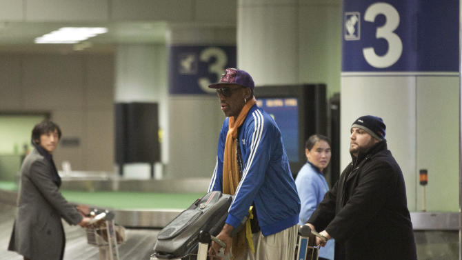 Former NBA basketball player Dennis Rodman pushes his luggage cart as he arrives at the Capital International Airport in Beijing from Pyongyang, Monday, Jan. 13, 2014. Rodman has checked into an undisclosed alcohol rehabilitation center to treat his long-time struggle with alcoholism, his agent says. (AP Photo/Alexander F. Yuan)