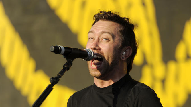 "FILE - In this July 30, 2011 file photo, Tim McIlrath of the band Rise Against performs during their set at the ""L.A. Rising"" concert at the Los Angeles Coliseum in Los Angeles. Their music video for ""Make It Stop (September's Children),"" a song about gay teens and suicide, is nominated in the new category Best Video with a Message at the 2011 MTV Video Music Awards on Sunday Aug. 28, 2011. (AP Photo/Chris Pizzello, file)"