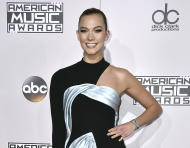 "FILE - This Nov. 20, 2016 file photo shows Karlie Kloss at the American Music Awards in Los Angeles. Kloss is apologizing for appearing in a fashion spread in Vogue's diversity issue styled as a geisha. The model, who has Danish and German roots, was photographed by Mikael Jansson in a black wig and wears a kimono in one shot and poses beside a sumo wrestler in another. In its introduction, Vogue writes that the spread is ""paying homage to geisha culture."" (Photo by Jordan Strauss/Invision/AP, File)"