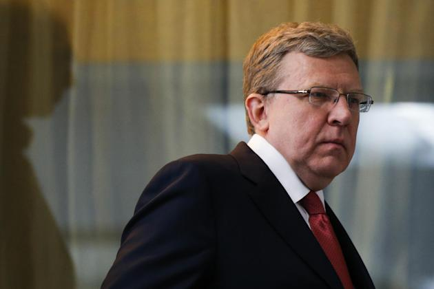 Russia's former finance minister Alexei Kudrin enters a hall to attend a round table to mark President Vladimir Putin's 15 years in office, some of the president's long-term allies questioned his
