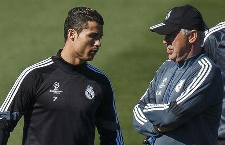 Real Madrid's coach Carlo Ancelotti stands next to Cristiano Ronaldo during their training session in Madrid