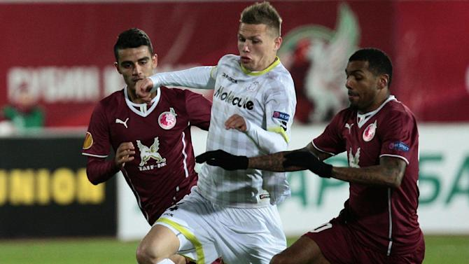 Rubin Kazan's Ruslan Abisov, left, and Yann M'Vila, right, challenge Zulte Waregem's Jens Naessens for the ball during their Europa League Group D soccer match in Kazan, Russia, Thursday, Oct. 3, 2013