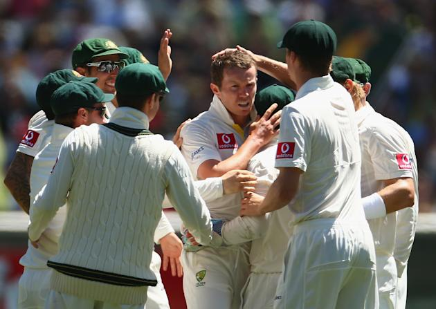 Peter Siddle of Australia celebrates taking the wicket of Mahela Jayawardene of Sri Lanka during day one of the Second Test match between Australia and Sri Lanka at Melbourne Cricket Ground on Decembe