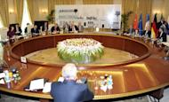 """File picture shows representatives of the P5+1 during a meeting with Iran's chief negotiator Saeed Jalili (R) in Baghdad on May 23. Tehran has """"no reason"""" to suspend its enrichment of uranium to 20 percent, one of the key demands of world powers engaging Iran in talks, the head of its Atomic Energy Organisation said"""