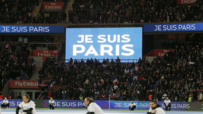 Spectators observe a minute of silence for the victims of the recent shootings in the French capital ahead of a French Ligue 1 soccer match between Paris St Germain and Troyes