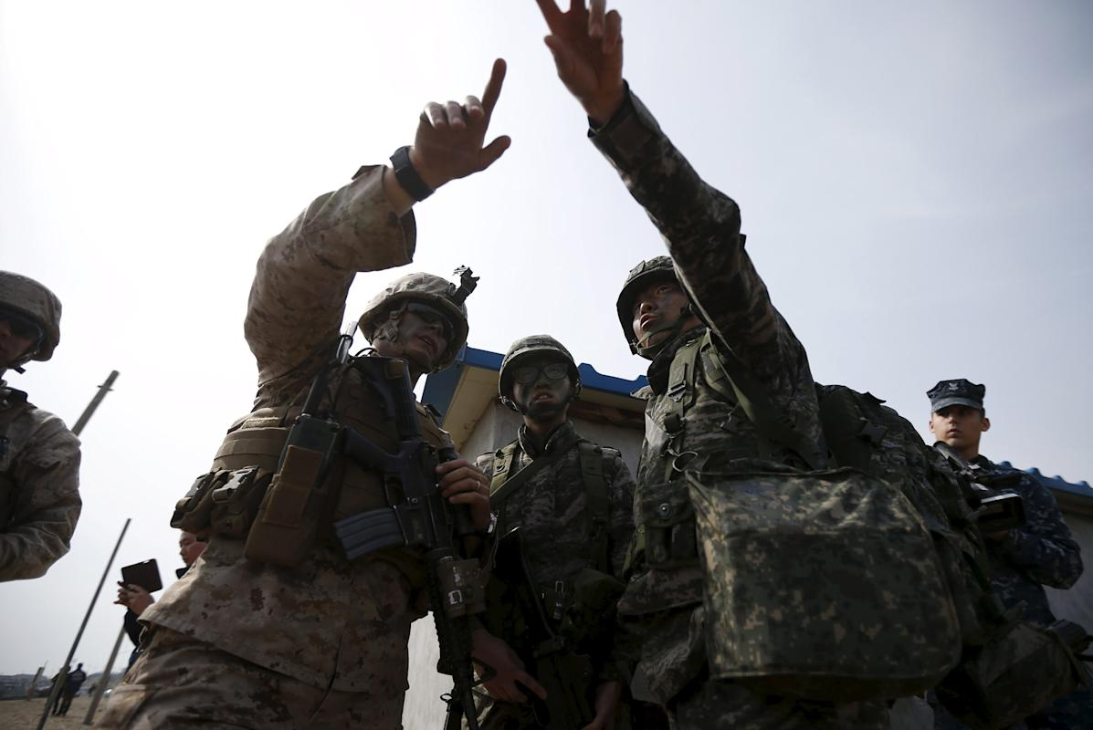 A file photo of a U.S. marine and South Korean marines participating in a U.S.-South Korea joint landing operation drill in Pohang
