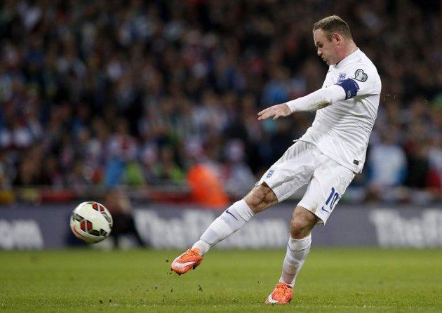 Wayne Rooney Kicking A Ball