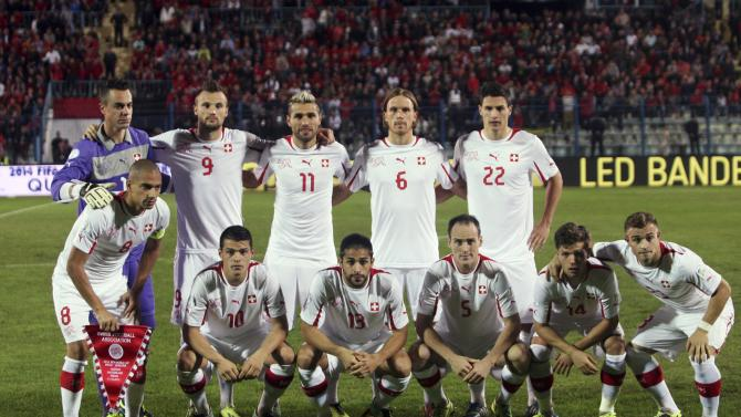 Switzerland's team poses for the media before their 2014 World Cup qualifying soccer match against Albania at Qemal Stafa stadium in Tirana