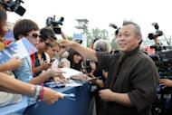 Korean film director Kim Ki-Duk, seen here signing autographs at the 69th Venice Film Festival on September 4, told AFP that the Korean film industry is still lacking compared to the European and American markets