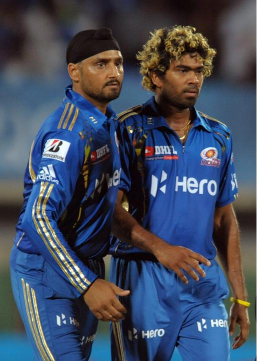 Mumbai Indians bowler Latish Malinga(R) celebrates with captain Harbhajan Singh  the wicket of Deccan Chargers Ravi Teja during the IPL Twenty20 cricket match between Deccan Chargers and Mumbai Indian