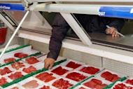"""File photo shows an employee arranging imported beef at a supermarket in Jakarta. The US trade representative has called for Indonesia to lift its import ban on some US beef products, saying there was """"no evidence"""" that a Californian mad cow case had tainted food markets"""