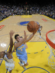 OAKLAND, CA - NOVEMBER 10: Danilo Gallinari #8 of the Denver Nuggets lays the ball up against Jarrett Jack #2 of the Golden State Warriors on November 10, 2012 at Oracle Arena in Oakland, California. (Photo by Rocky Widner/NBAE via Getty Images)