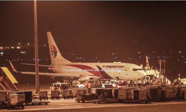 Malaysia Airlines flight MH192 bound for Bangalore turned back towards and parked at Kuala Lumpur International Airport in Sepang, Malaysia, Monday, April 21, 2014, after its right landing gear malfun