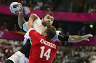 Spain's centreback Joan Canellas Reixach jumps to shoot during the men's preliminaries Group A handball match Denmark vs Spain for the London 2012 Olympics Games on July 31, 2012 at the Copper Box hall in London. AFP PHOTO/ JAVIER SORIANO