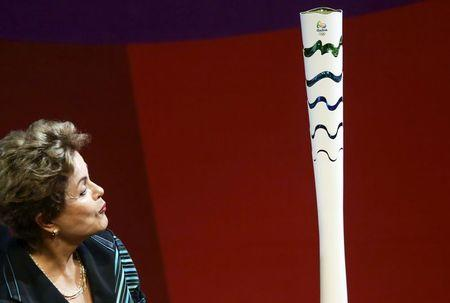 Brazil's President Rousseff looks at an Olympic torch model in Brasilia