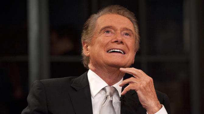 "Regis Philbin shares a laugh during his farewell episode of ""Live! with Regis and Kelly"", in New York, Friday, Nov. 18, 2011.  After more then  28 years, Philbin signed off U.S. morning television on Friday, long after setting a world record for the most time on TV.   Philbin,  80,  has logged more than 17,000 hours on television in a career that dates back to the 1960s. He gained prime-time fame as host of ""Who Wants to Be a Millionaire"" a decade ago. But his enduring impact was as a morning show host, turning stories about something as simple as a dinner out on the town into compelling viewing.   (AP Photo/Charles Sykes)"