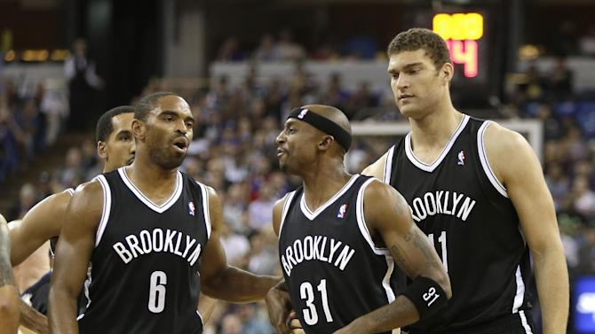 Brooklyn Nets guard Jason Terry, center, is restrained by teammates Alan Anderson, left, and Brooks Lopez, after exchanging heated words with Sacramento Kings guard Greivis Vasquez during the fourth quarter of an NBA basketball game in Sacramento, Calif., Wednesday, Nov. 13, 2013. The Kings won 107-86