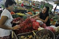 """A customer buys chilis at a market in Jakarta. """"Food is the biggest driver of inflation... August inflation is due to the Muslim fasting month and Lebaran (Eid celebrations),"""" the Central Statistics Agency said"""