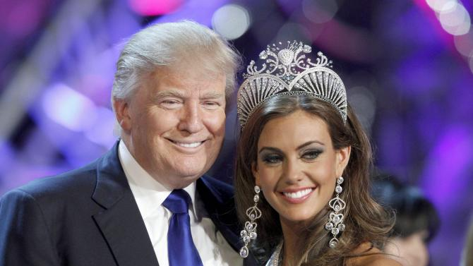 File photo of Donald Trump, co-owner of the Miss Universe Organization, posing with Erin Brady at a news conference after she was crowned Miss USA 2013 in Las Vegas