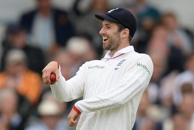 Cricket: England's Mark Wood celebrates after taking a catch to dismiss New Zealand's Tim Southee (not pictured)