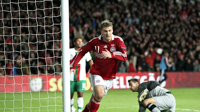 Denmark's Nicklas Bendtner jubilates after scoring to take the score to 2-0, when Denmark met Portugal during their Euro 2012, group H, qualifying soccer match at Parken Stadium, Copenhagen, on Tuesday, Oct. 11, 2011.  Denmark defeated Portugal 2-1. (AP Photo/POLFOTO, Lars Krabbe)  DENMARK OUT