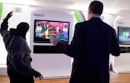 "Microsoft representatives dance to Microsoft's Xbox 360's 'Dance Central 2' using the Kinect at the 2012 International Consumer Electronics Show at the Las Vegas Convention Center January 10, in Las Vegas, Nevada. Microsoft posted quarterly net income of $5.11 billion on record-high revenue on the cusp of what executives billed as a huge ""product launch wave"" promising even better days ahead"