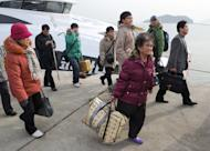 This file photo shows residents returning to the South Korea-controlled island of Yeonpyeong near the disputed waters in the Yellow Sea, on December 21, 2010, almost a month after a North Korean artillery attack which killed four S.Koreans