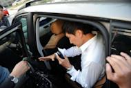 """Pastor Kong Hee (C) leaves court in Singapore on June 27, 2012. Hee, 47, faces three charges of """"criminal breach of trust"""" relating to the misuse of the funds of the City Harvest Church, one of Singapore's biggest with a membership of over 30,000"""