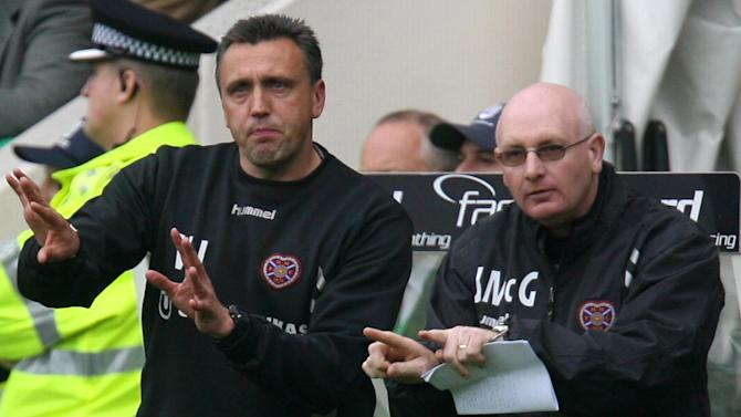 John McGlynn was pleased to see his Hearts side prevail over 10-man St Johnstone
