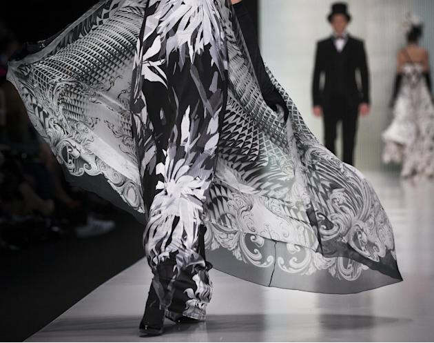 A model displays creation by Russian designer Slava Zaitsev during a Fashion Week in Moscow, Russia, Friday, March 27, 2015. (AP Photo/Alexander Zemlianichenko)