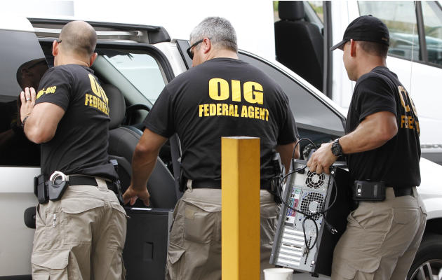FILE - In this May 2, 2012, file photo, Federal agents with the Office of Inspector General load computers seized from Willsand Home Health Agency, Inc. into a van in Miami. Over the past decade, Sout