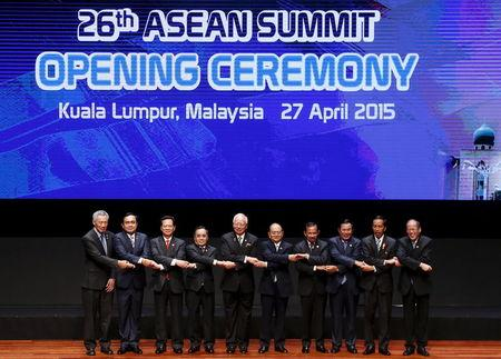 ASEAN leaders pose for a photo during the opening ceremony of the 26th ASEAN Summit in Kuala Lumpur, Malaysia
