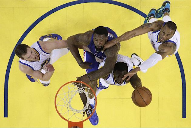 Los Angeles Clippers' DeAndre Jordan, center in blue, battles for a rebound against Golden State Warriors' David Lee, left, Draymond Green, bottom center, and Andre Iguodala, right, during the