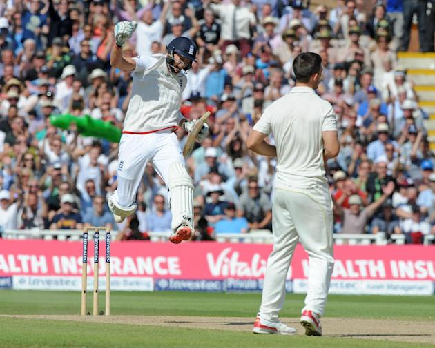 England's Joe Root, left, celebrates after England beat Australia by 8 wickets during day three of the third Ashes Test cricket match, at Edgbaston, Birmingham, England, Friday, July 31, 2015. (AP Pho