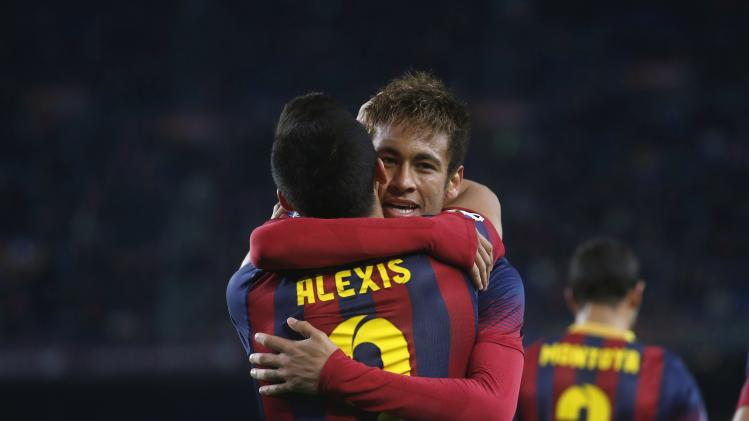 Barcelona's Neymar and Alexis Sanchez celebrate a goal against Villarreal during their Spanish First Division soccer match at Camp Nou stadium in Barcelona