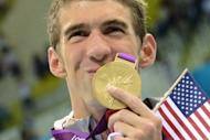 Gold medalist USA's Michael Phelps kisses his gold medal after the podium ceremony of the men's 4x200m freestyle relay final during the swimming event at the London 2012 Olympic Games on July 31, 2012 in London