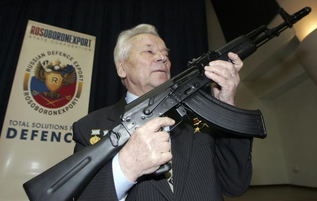 File picture of Kalashnikov posing with a model of his rifle in Moscow