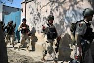 Afghan special forces troops walk towards the scene of an attack in Kabul in April 2012. US special forces in Afghanistan have suspended training for about 1,000 Afghan police recruits to vet existing members, the military said Sunday, after a surge in insider attacks on NATO