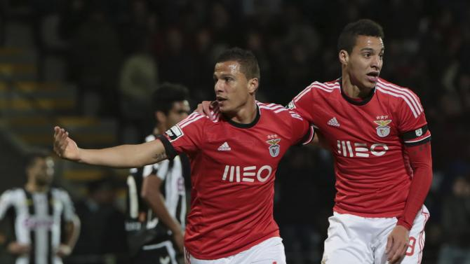 Benfica's Lima celebrates his goal with his teammate Machado during their Portuguese Premier League soccer match against Nacional at Choupana stadium in Funchal