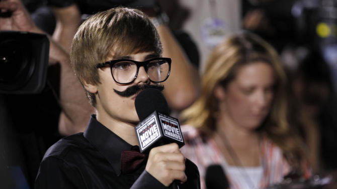 """FILE - In this Friday, Jan. 14, 2011 file photo, Justin Beiber is seen interviewing on the red carpet at the 16th Annual Critics' Choice Movie Awards in Los Angeles. Dubai newspapers quote a police official Tuesday, May 7, 2013 saying the megastar racked up a """"number"""" of speeding fines before being pulled over. The official was not named and no other details were given. The Dubai police media office referred to the newspaper reports when asked for comment. (AP Photo/Matt Sayles, File)"""