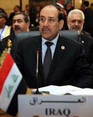 A handout picture released by the Iraqi Prime Minister's Office shows Iraqi Premier Nuri al-Maliki attending the 12th summit of the Organisation of Islamic Cooperation (OIC) in Cairo, on February 6, 2013. Egyptian President Mohamed Morsi has urged Syrian opposition groups to unify, as he addressed leaders of Islamic states at a summit that also tackled the battle against militants in Mali