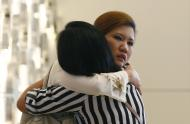 Relatives of a passenger onboard the missing Malaysia Airlines flight MH370 cry inside a hotel they are staying, in Putrajaya March 10, 2014. China urged Malaysia to step up the search for a Malaysia Airlines jetliner that went missing with 239 people on board, about two-thirds of them Chinese, and said it has sent security agents to help with an investigation into the misuse of passports. REUTERS/Samsul Said (MALAYSIA - Tags: TRANSPORT TRAVEL TPX IMAGES OF THE DAY)