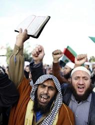 """Members of Egypt's Muslim Brotherhood shout slogans while gathering in central Cairo on December 11, 2012. """"It's the last battle for Islam against the secularists who want to ruin Egypt,"""" said protester Ahmed Alaa, who was bussed in from the north of the country"""