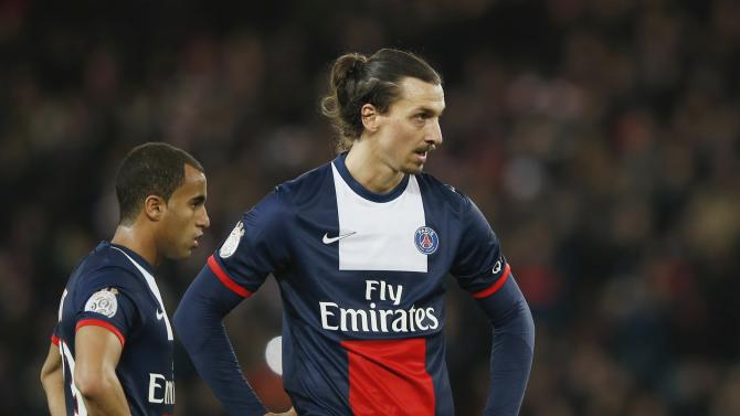 Paris St Germain's Ibrahimovic and Lucas react during French Ligue 1 soccer match against Lille in Paris