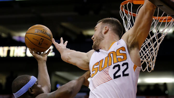 Memphis Grizzlies' Zach Randolph, left, gets the shot past Phoenix Suns' Miles Plumlee (22) during the first half of an NBA basketball game on Thursday, Jan. 2, 2014, in Phoenix