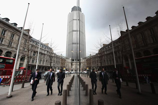 LONDON, ENGLAND - JANUARY 25: City workers walk through London's financial district after it was announced that UK economy shrank by 0.2% during the last quarter of 2010 on January 25, 2012 in London, England. The official economic figures, released by the Office for National Statistics, come a day after they calculated that Government debt had risen to an all-time record of 1 trillion GBP. (Photo by Oli Scarff/Getty Images)