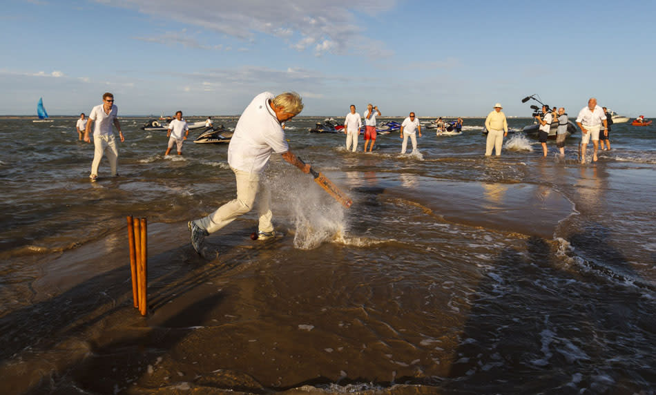 Annual Bramble Bank cricket match in the sea