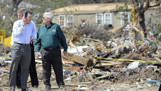 Texas Governor Rick Perry, left, and Wayne McKethan, Granbury City Manager, tour storm-damaged areas in Granbury, Texas, on Friday May 17, 2013. On Wednesday, powerful storms produced 16 tornadoes in the area that left six dead. (AP Photo/The Fort Worth Star-Telegram, Max Faulkner)  MAGS OUT; (FORT WORTH WEEKLY, 360 WEST); INTERNET OUT