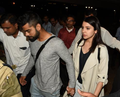 Mumbai: Indian cricketer Virat Kohli and Bollywood actress Anushka Sharma arrive from Australia with the Indian cricket team, at the Chhatrapati Shivaji International Airport, in Mumbai on March 27, 2